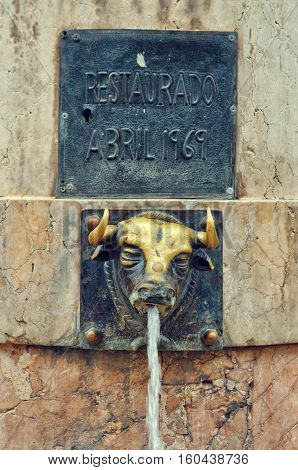 Teruel Spain. - September 15 2015: El Torico fountain in Plaza Carlos Castel. Closeup of the fountain with metal bull head.
