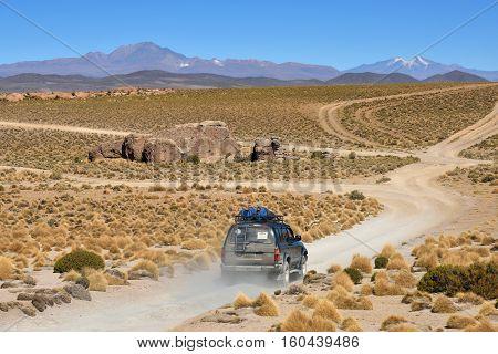 ATACAMA DESERT - AUGUST 30: Off-road car at Atacama Desert in Bolivia on August 30 2016. Atacama Desert is the driest non-polar desert in the world