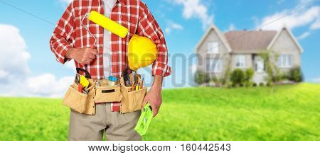 Builder handyman with paint roller.