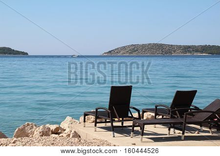 Adria / Beautiful Croatian beach with sun beds