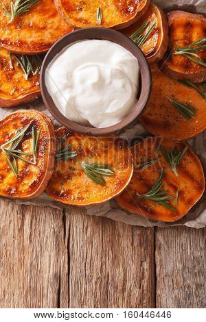 Roasted Sweet Potato With Sour Cream Closeup. Vertical Top View