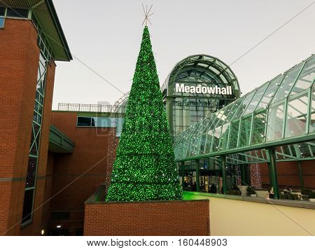 SHEFFIELD ENGLAND - NOVEMBER 29: Sheffield Meadowhall centre exterior with Christmas tree lit in green. In Sheffield South Yorkshire England. On 29th November 2016.