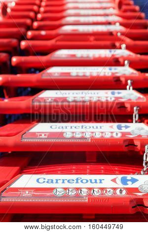 Macon, France - October 30, 2016: Carrefour shopping cart. Carrefour is a french multinational retailer headquartered in France and it is one of the largest hypermarket chains in the world