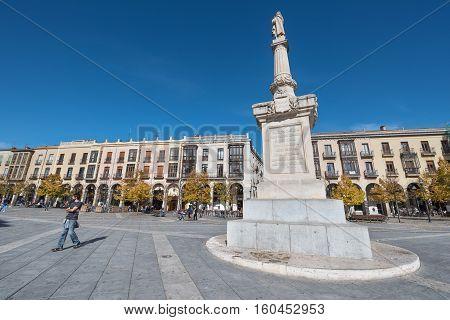 Avila Spain - October 27: Tourist visiting Santa Teresa square on October 27 2016 in the ancient medieval city of Avila Spain.