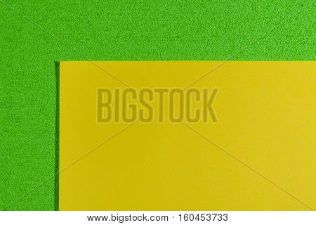Eva foam ethylene vinyl acetate smooth lemon yellow surface on apple green sponge plush background