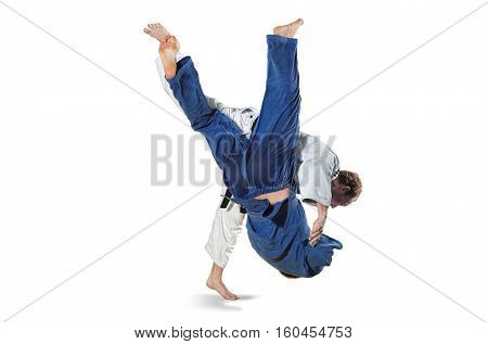 The two judokas fighters fighting men isolated on white background