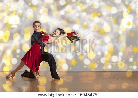 Dance beautiful couple dancing ballroom dancing on color background