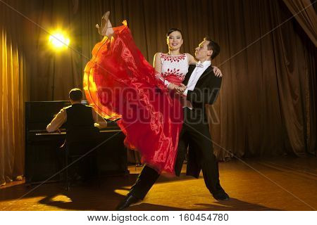 Dance beautiful couple dancing ballroom dancing on dark background
