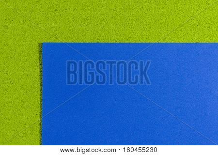 Eva foam ethylene vinyl acetate smooth blue surface on apple green sponge plush background