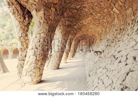 naturally arranged stone pillars pathway in Park Guell Bracelona