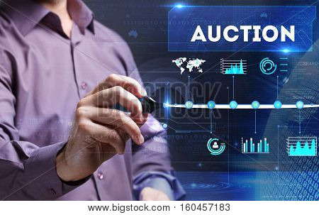 Technology, Internet, Business And Marketing. Young Business Man Writing Word: Auction
