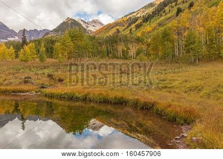 a fall reflection of the maroon bells Aspen Colorado