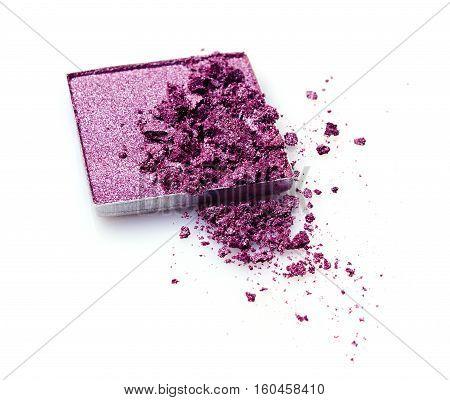Purple crushed eyeshadow isolated on white background