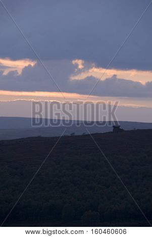 Evening sun set lights up the clouds over the Peak District, Derbyshire, UK