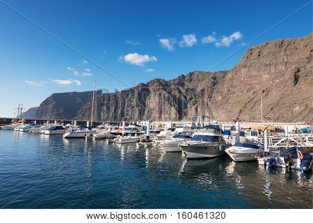 LOS GIGANTES TENERIFE SPAIN - MARCH 25 2016: Yatchs and Boats in small sea port on March 25 2016 in Los GigantesTenerife Canary Islands Spain