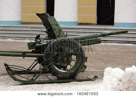 Russian historical military green gun on runners that facilitate transportation