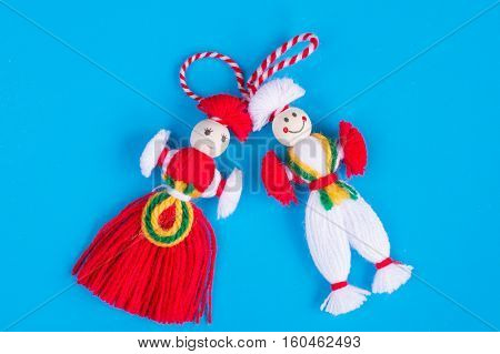 Bulgarian Martenitsa spring sign on blue background