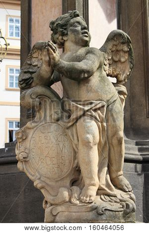 Sculpture of cherub outside Loreta Sanctuary in Prague, Czech Republic
