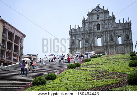 Macau - July 13 2006: People visiting the ruins of St. Paul's Cathedral. Built from 1602 to 1640. In 2005 St. Paul's was officially listed as part of Historic Centre of Macau a UNESCO World Heritage Site