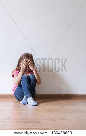 Sad Little Girl Child Alone Domestic. Copyspace.
