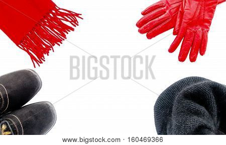 Women black winter boots a red cashmere scarf a black angora cap and red leather gloves isolated on white background.