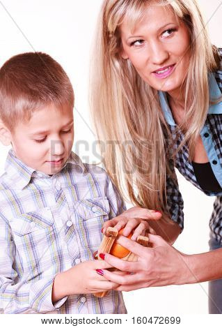 Boy With Mother Hold Sling Shot And Mandarine.