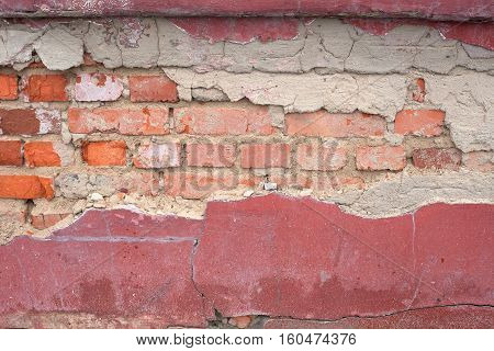 destroyed brick wall background. exposed wall degradation
