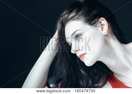portrait photo of a blue eye girl in darkness