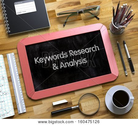 Keywords Research and Analysis Handwritten on Small Chalkboard. Top View of Office Desk with Stationery and Red Small Chalkboard with Business Concept - Keywords Research and Analysis. 3d Rendering.