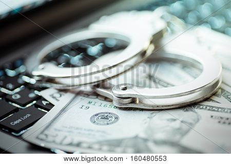 Internet crimes and handcuffs high quality and high resolution studio shoot