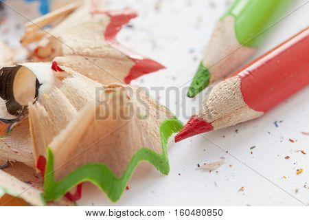 Sharpened pencils and wood shavings. Close up shot.