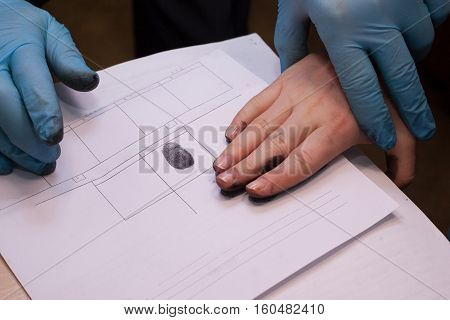 Expert Takes A Fingerprint Of The Suspect