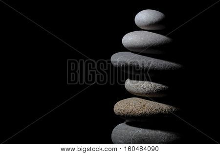 Serenity and interrelation of stones on black background