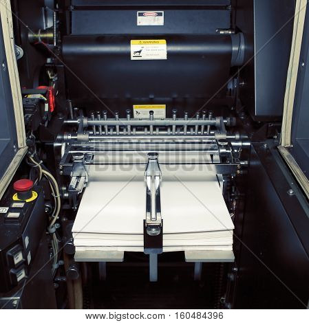 Fragment of digital offset machine with paper ready for printing.