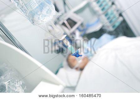 Intravenous drip against patient bed. Modern treatment