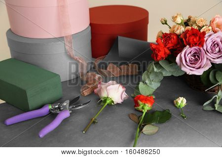 Beautiful flowers with gift boxes on table
