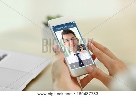Video conference with financial advisor on smartphone. Investment and tax concept.