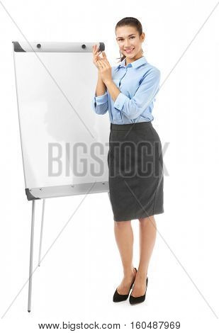 Young businesswoman with flip chart on white background