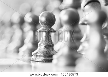 chess pawns lined up in a row on the board