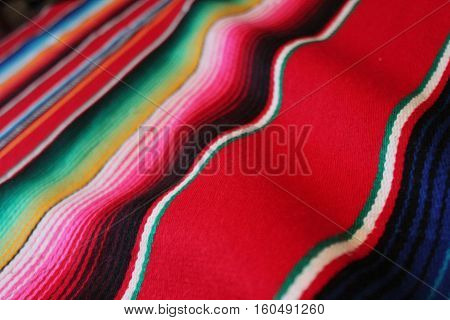 Mexico traditional cinco de mayo rug poncho fiesta background with stripes copy space