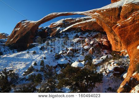 Snow covered horizontal image of Landscape Arch in winter