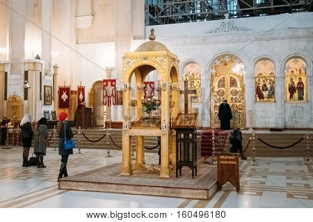 Tbilisi, Georgia - October 21, 2016: Parishioners pray in the Holy Trinity Cathedral of Tbilisi. Sameba is the main cathedral of the Georgian Orthodox Church
