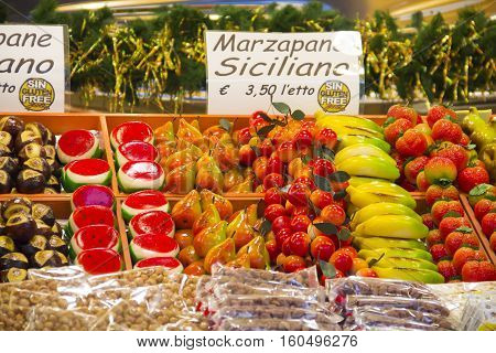BERGAMO, ITALY - DECEMBER 1, 2016: Stall with marzipan sweets on Christmas market