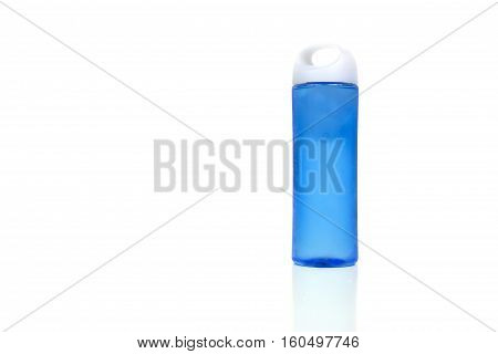 Cold water in a blue plastic bottle over a white background.