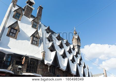 ORLANDO USA - NOVEMBER 1 2016. Snow covered roofs of Hogsmead at The Wizarding World Of Harry Potter at Universal Studios Orlando. Universal Studios Orlando is a theme park in Orlando Florida USA.