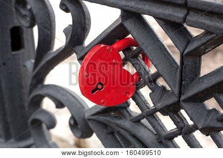 iron lock in form of heart on vintage fence