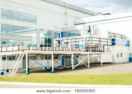 New modern hi-tech factory building with a cooling system. Workplaces. Employment.