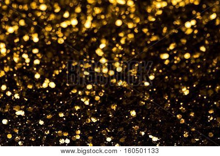 Glitter and glow soft gold bokeh shining light abstract dreamy sparkle background