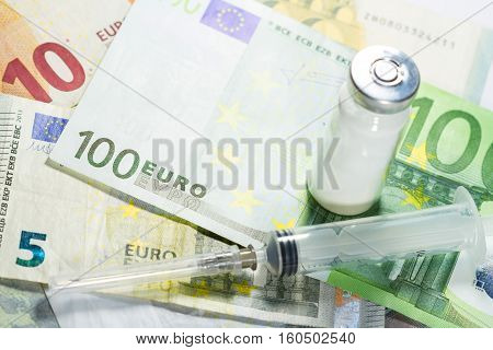 Euro Banknotes With Medical Instruments