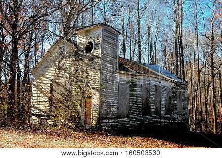 Pittsboro North Carolina - December 7 2016: Delapidated ruins of an abandonned wooden church on Route 15-501 near Bynum